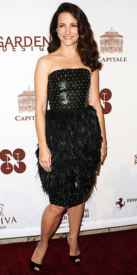 Kristin Davis in a black Oscar De La Renta cocktail dress with feather detailing