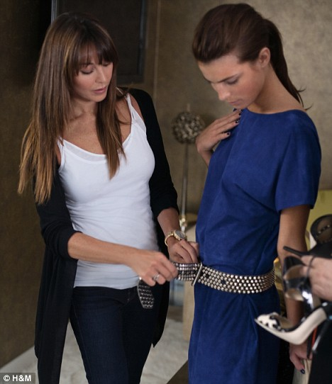 Jimmy Choo president Tamara Mellon with a model wearing designs for the Jimmy Choo collection for H&M