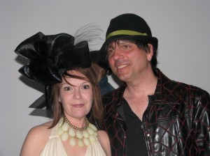 I love the elaborate hat and the statement necklace.